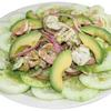 Our aguachiles is a plate of cucumbers, avocado, onions, and shrimp marinated in a very spicy salsa.