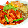 Chicken fajitas come with rice, beans, guacamole, and your choice of tortillas.