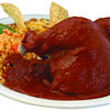 The pollo en mole is half a chicken smothered in a homemade mole, accompanied by rice, beans, and your choice of tortillas.