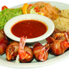 Costa Azul is a plate with cheese-filled shrimp wrapped in bacon with a side of specially made dipping salsa. Sides of rice, beans, and guacamole, and tortillas included.